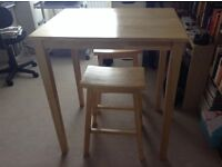 Wooden breakfast table with two stools