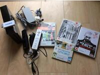 Wii + 2 remotes + 4 games Very good conditions