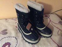 Sorel Caribou Snow boots. Never worn. Size 7