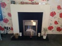Electric fire and surround. Very good condition