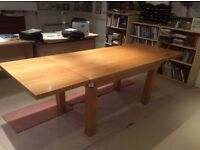 Solid Oak Table, seats up to 12 with extension leaves.