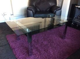 I have a large Glass coffee table with black shelf chrome legs very heavy
