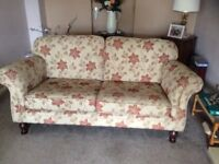 Two matching sofas and footstool