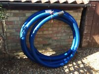 Approx 15 metres of 80mm perforated land drainage pipe ( Polypipe) , c/w coupler. New, not used.