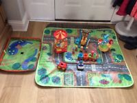 happyland storage box, with some people, cars and fun fair rides