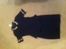 Beautiful black size 10 dress with diamanté decoration on collar and sleeves - with peplum
