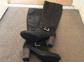 Black size 7 pull up boots.