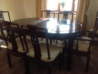 Carved dark wood dining table and chairs
