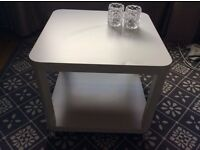 white coffee table on wheels - ikea (2 months old)