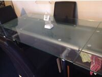 Glass extendable table and leather chairs