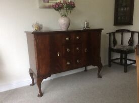 Old Mahogany Sideboard, three Drawers, Two cupboards. Cabriole legs.
