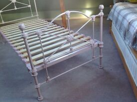 Pale pink iron frame bed from Laura Ashley.