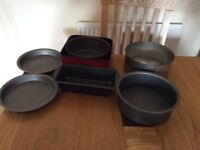 7 used assorted baking tins,Square tin ideal for Christmas cake