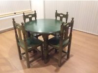 An extendable table with 4 matching chairs