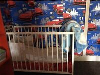 Complete baby's cot with decorations,mattress, Mattress cover and pillow and blanket cases