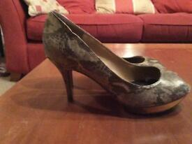 Gold snakeskin pattern shoes