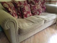 Sofa -three seater and matching chair plus large and small cushions.