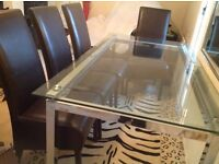 Glass Table and Chairs - In very good condition.