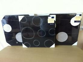 3 brand new sealed black wall hangings