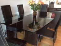 Furniture village quality black and clear glass dining table
