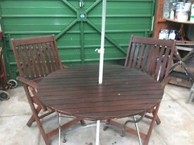 Table and two chairs umbrella dark wood