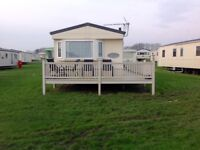 Quantity of caravan decking, L shaped, set of steps with gate, in excellent condition.