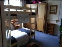 Nearly new IKEA pine bunk beds, quality mattresses, fitted sheets,duvets and covers and pillow cases