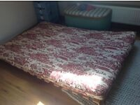 Futon/Sofa bed excellent condition wooden base with mattress in orange Egyptian hieroglyphics fabric