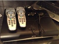 Sky hd box with two remotes io connection and a magic eye