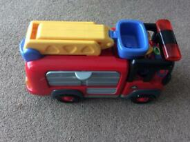 A big toy fire engine with sounds