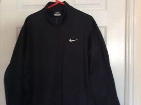 Black Nike tracksuit top