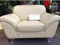 2 DFS Leather Chairs and Footstool on metal legs in excellent condition