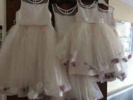 4 bridesmaid/flower girl dresses and fur wraps