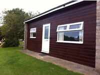TWO REFURBISHED HOLIDAY CHALETS FOR SALE ON BIDEFORD BAY HOLIDAY PARK - GREAT BUSINESS OPPORTUNITY
