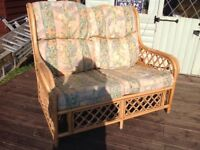 Cane furniture. For conservatory or summer house. Some wear and tear to cushion covers,