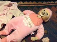 Baby annabell and clothes and pushchair