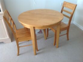 Circular Dining Table with two chairs