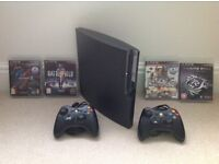 Sony PS3 120Gb+ 2 controllers & 4 games.