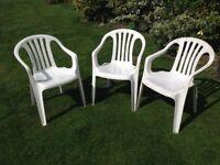 White plastic garden chairs x3