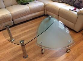 Glass coffee table with swivel table underneath extra table