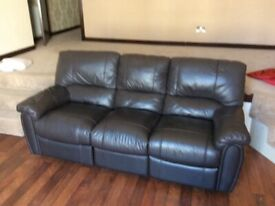 Three leather seater with leg rests