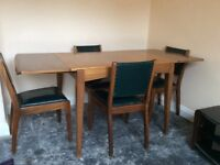 Wood expanding dining table and four chairs from late 1950