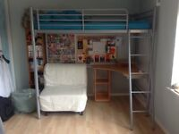 High loft metal bed in very good condition with wood desk underneath and an Ikea single chair bed