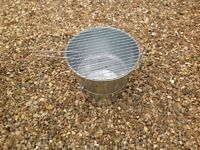 Collapsable bbq bucket stainless steel,never used,includes two racks with handles