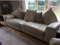 A cream leather 3 piece suite