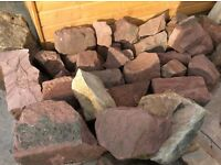 Stones rocks various sizes red sandstone , must uplift. First reasonable offer, £40 ono