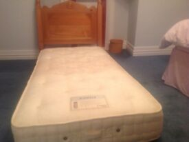 Single Pocket Sprung Mattress. Hardly used. With Pine headboard.