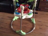BABY JUMPEROO AND A FEEDING CHAIR