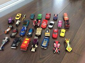 A few dozen small toy cars.