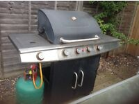 Free Gas BBQ with 4 burners and a large grill plate.